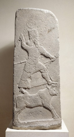 This Assyrian stela from Arslan Tash in northern Syria (8th century BCE), now in the Louvre Museum, shows Adad in a characteristic pose: mounted on a bull, brandishing lightning bolts